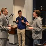 Students approached the speakers (shown here: Chad Bouton) with questions after the presentation.